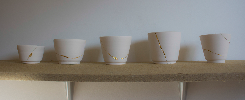 shelf-of-ceramic-pots.png