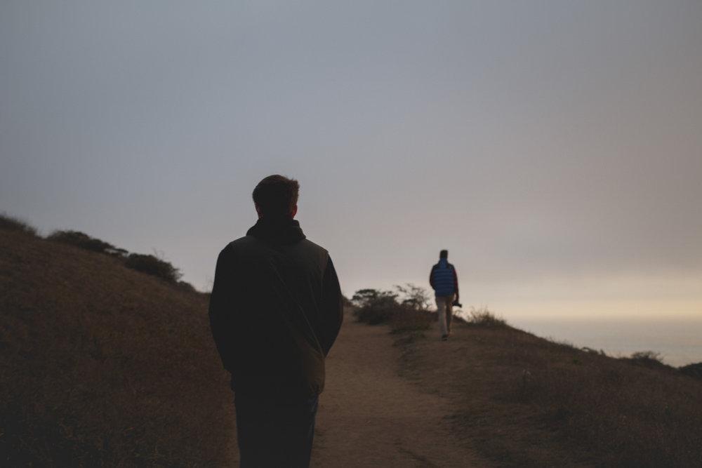 friends-walking-along-coast-point-reyes.jpg