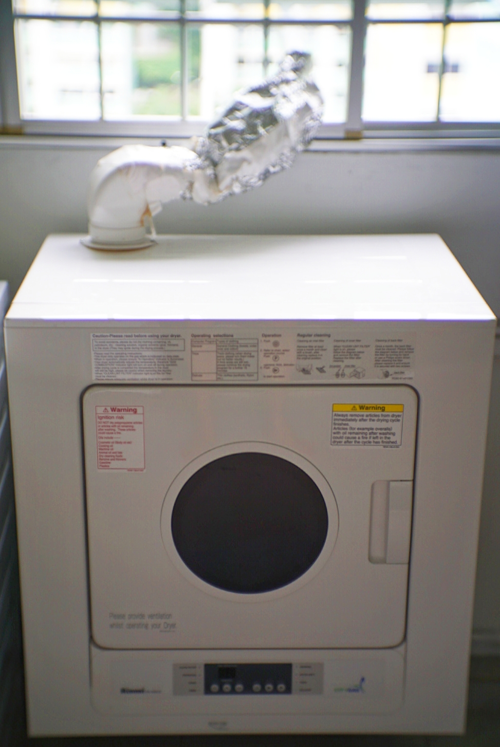 """The Rinnai RD-600CG gas clothes dryer, with our makeshift aluminium """"vent""""."""