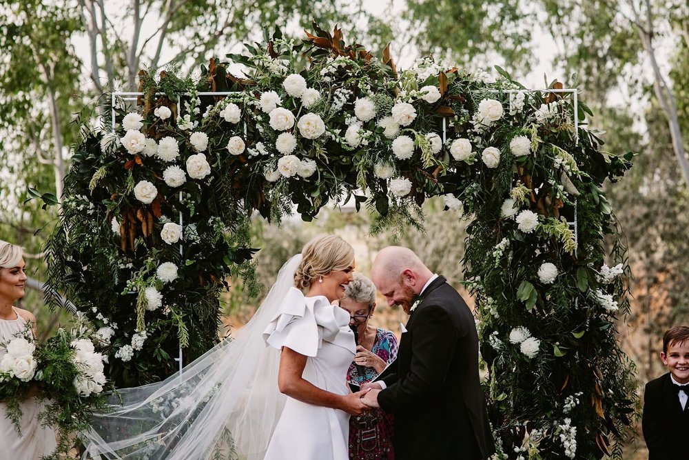 wedding arbour creating a stunning ceremony backdrop