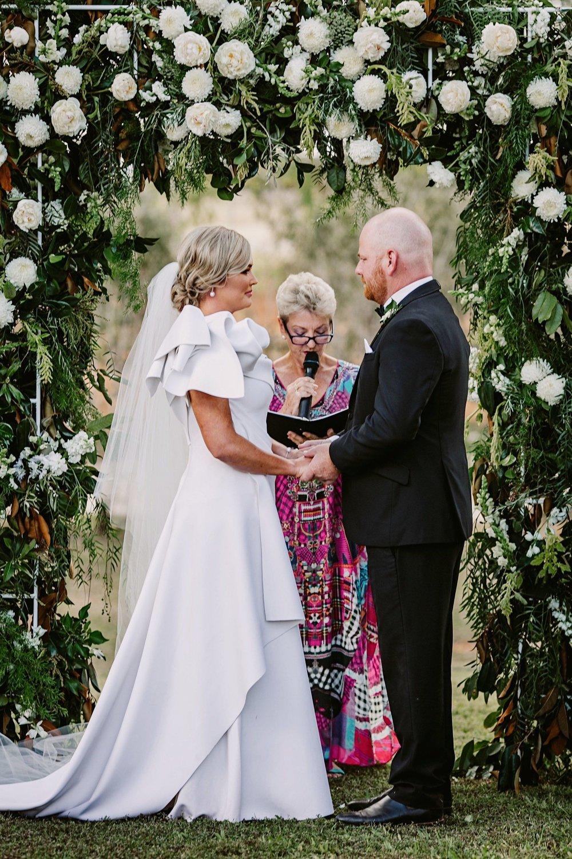 Katherine mayor, marries Georgia and Reid under floral arbour