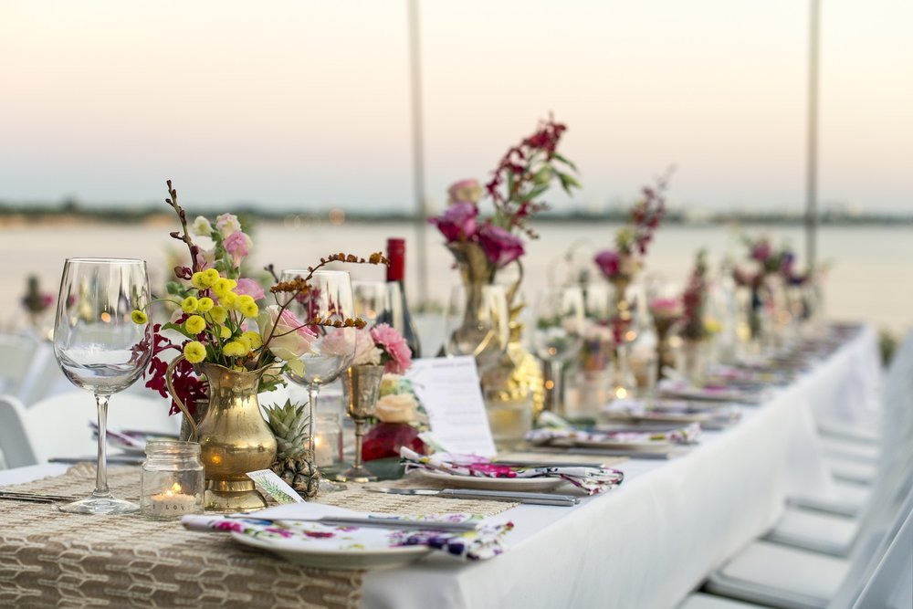 wedding guests enjoy sunset over Fannie Bay from Pee Wees lawns