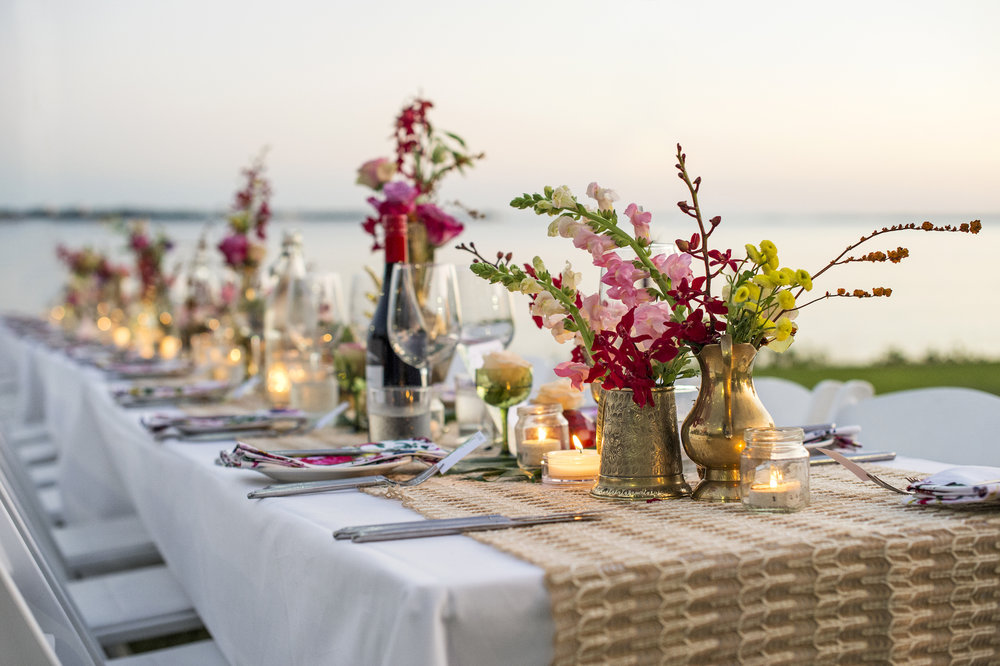 wedding guest tables filled with flowers