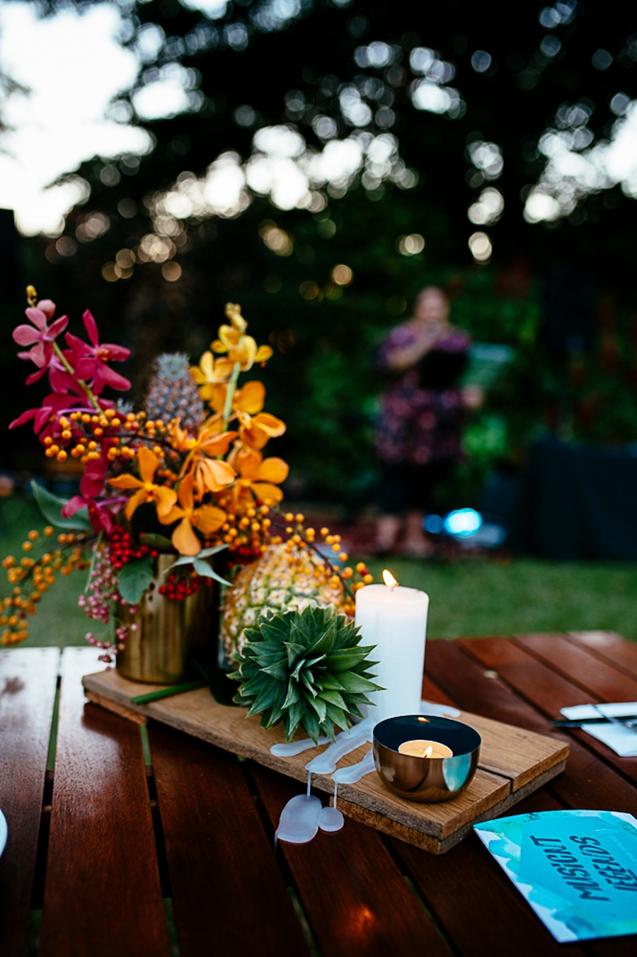 tropical flowers, pineapples and candlelight