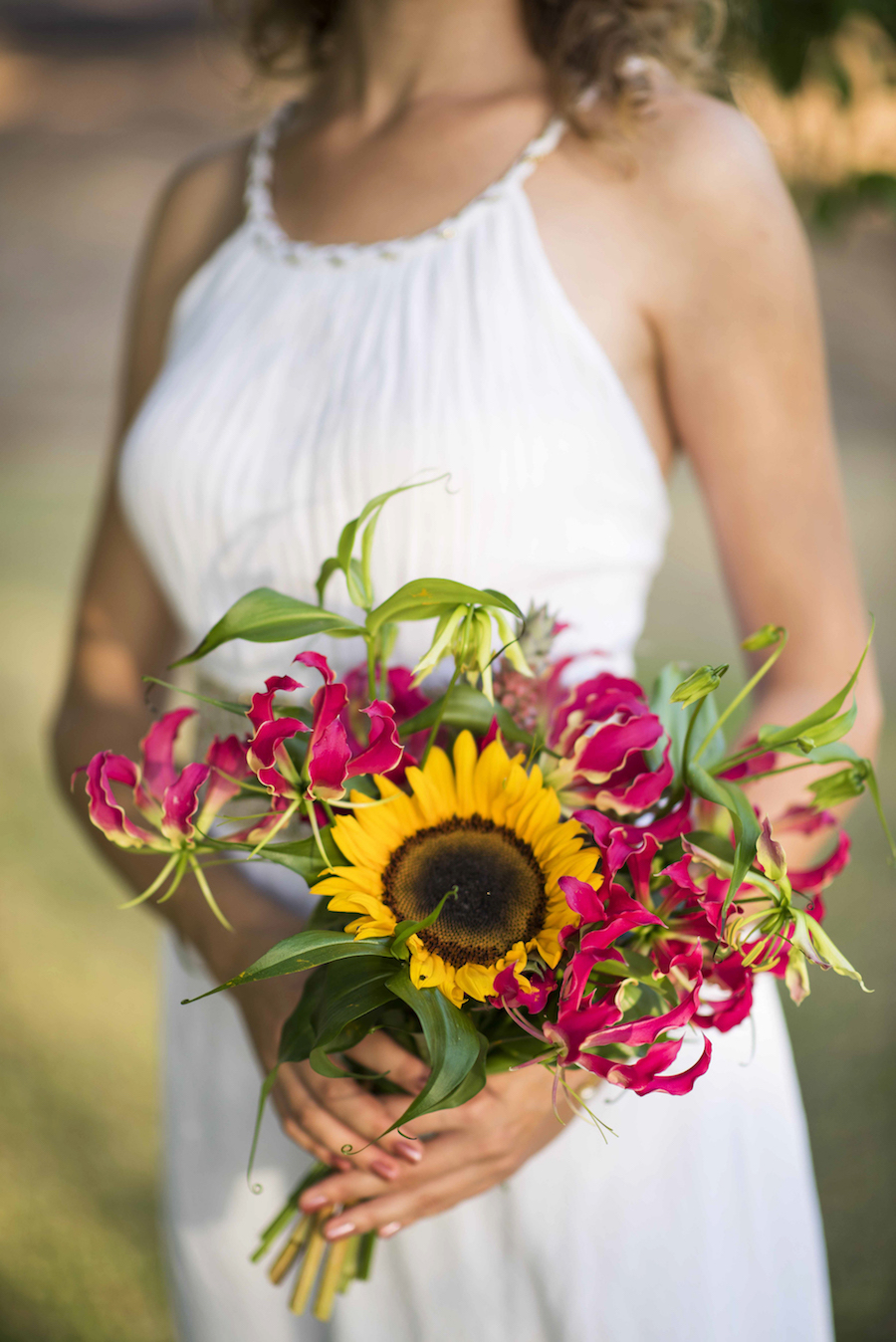 hand tied bouquet of Darwin grown flowers, including gloriosa, sunflowers and ornamental pineapples