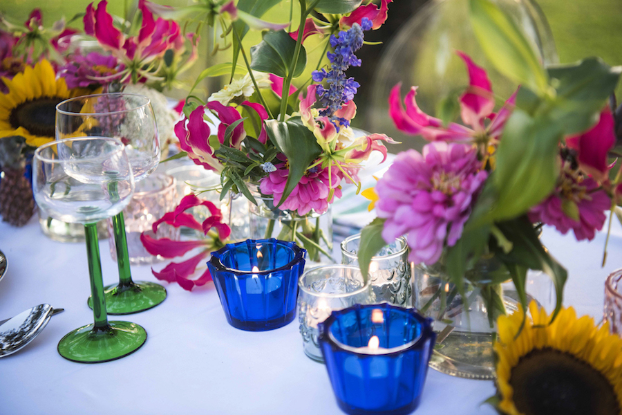 guest table flowers include NT grown zinnia, gloriosa and sunflowers