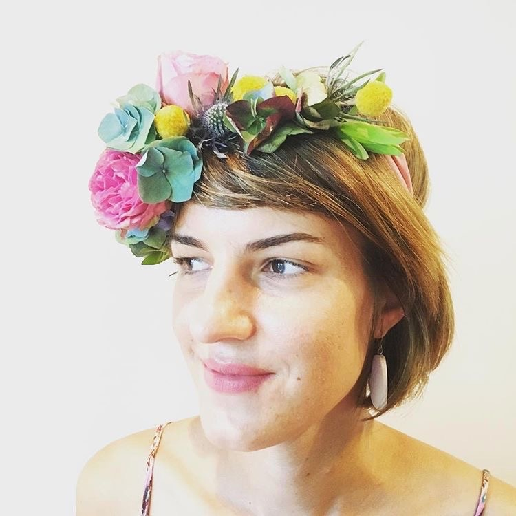Maria Okwa wears flower crown at Darwin, NT, Australia