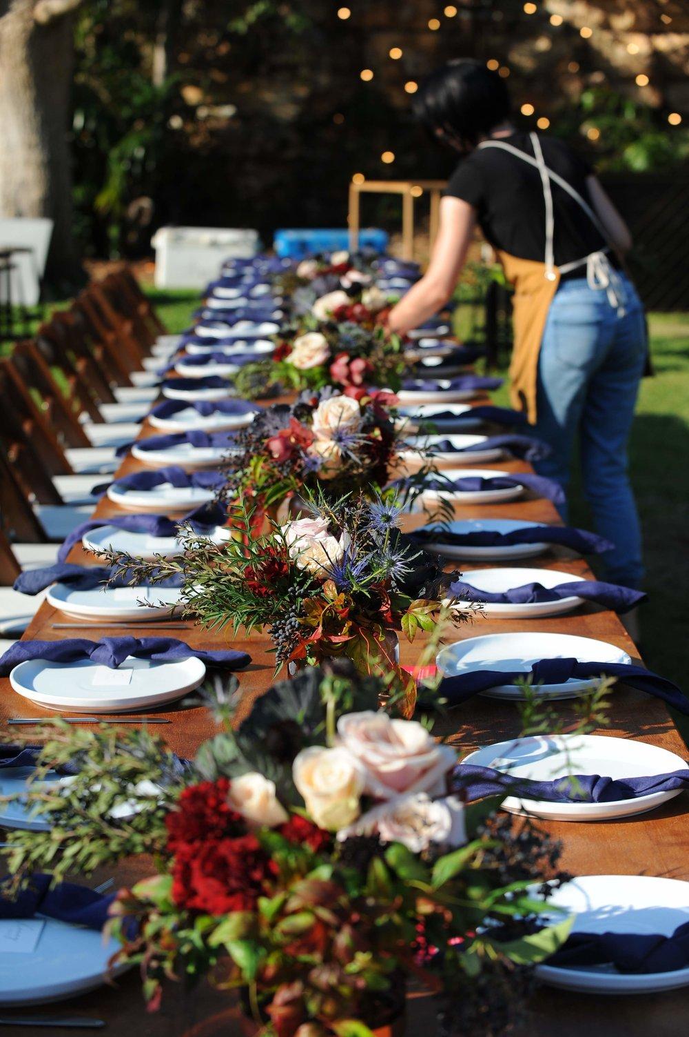 Beija Flor florist, Bonnie creating gorgeous table florals at Darwins Museum venue