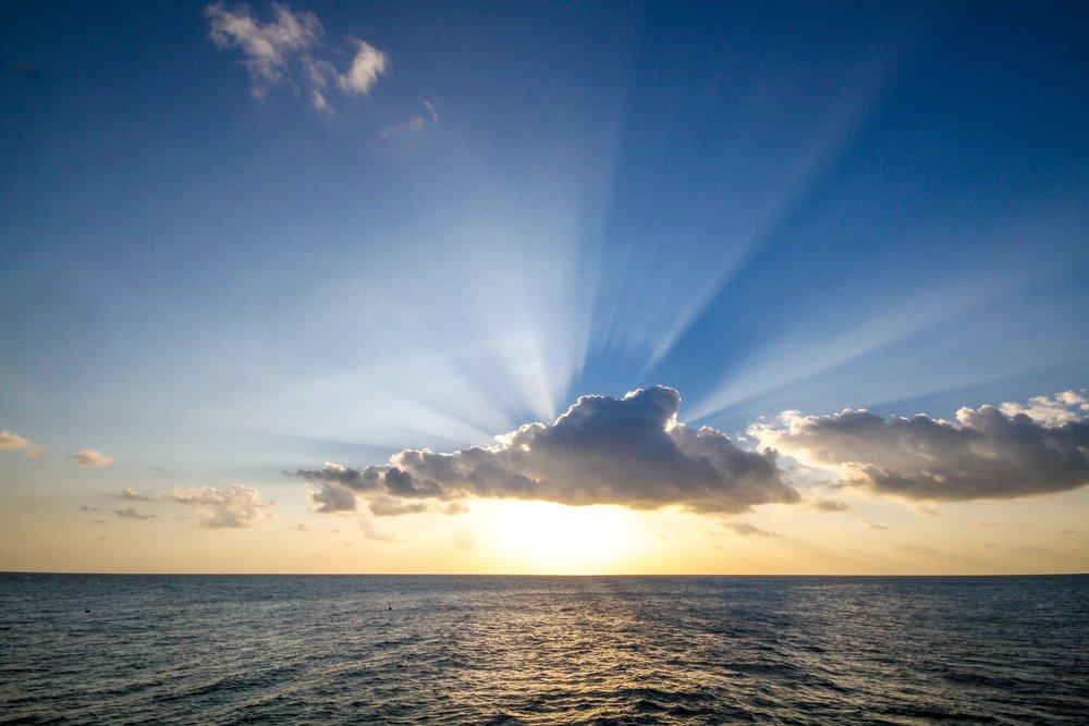 sun-setting-over-ocean_4460x4460.jpg