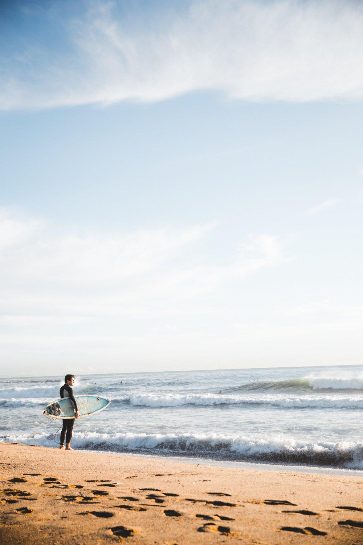surfer-standing-by-ocean_4460x4460.jpg