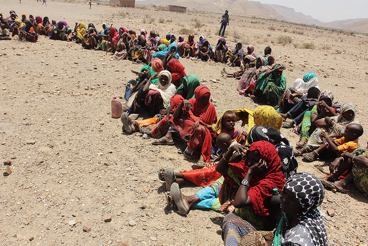 Families in Ethiopia wait to receive food and supplies during the 2011 East Africa Crisis