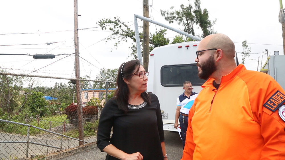 Jose Varguez talks logistics with one of the community leaders.