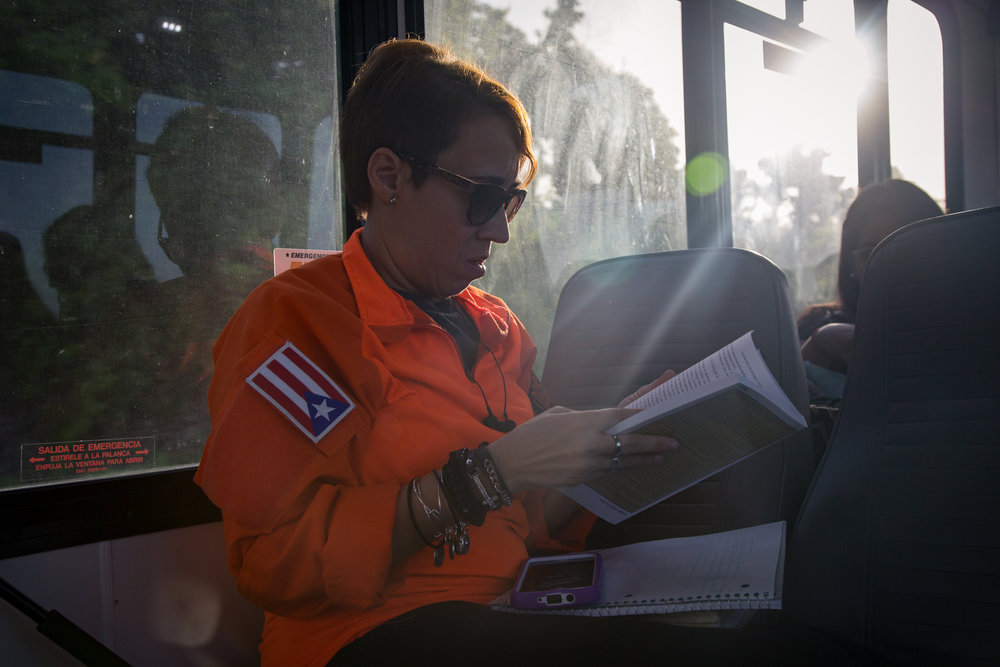 Ingrid Morales looks over some notes on the way to the community.