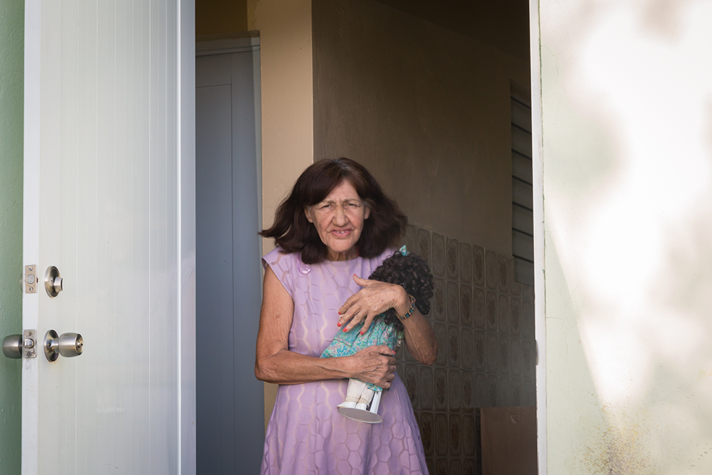 Julia has been living alone since her family moved to the US. Ingrid, of Iniciativa Communitaria, gave her a doll to keep her company.