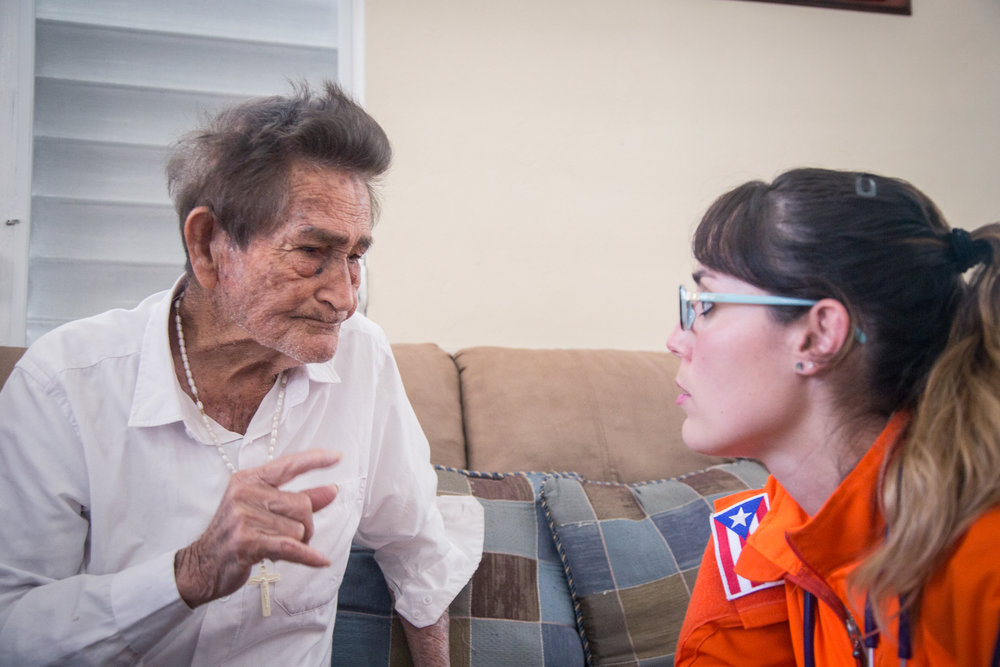 Doctor Marisol speaks with a patient on one of their visits. Gil and his wife have been married for around 60 years.