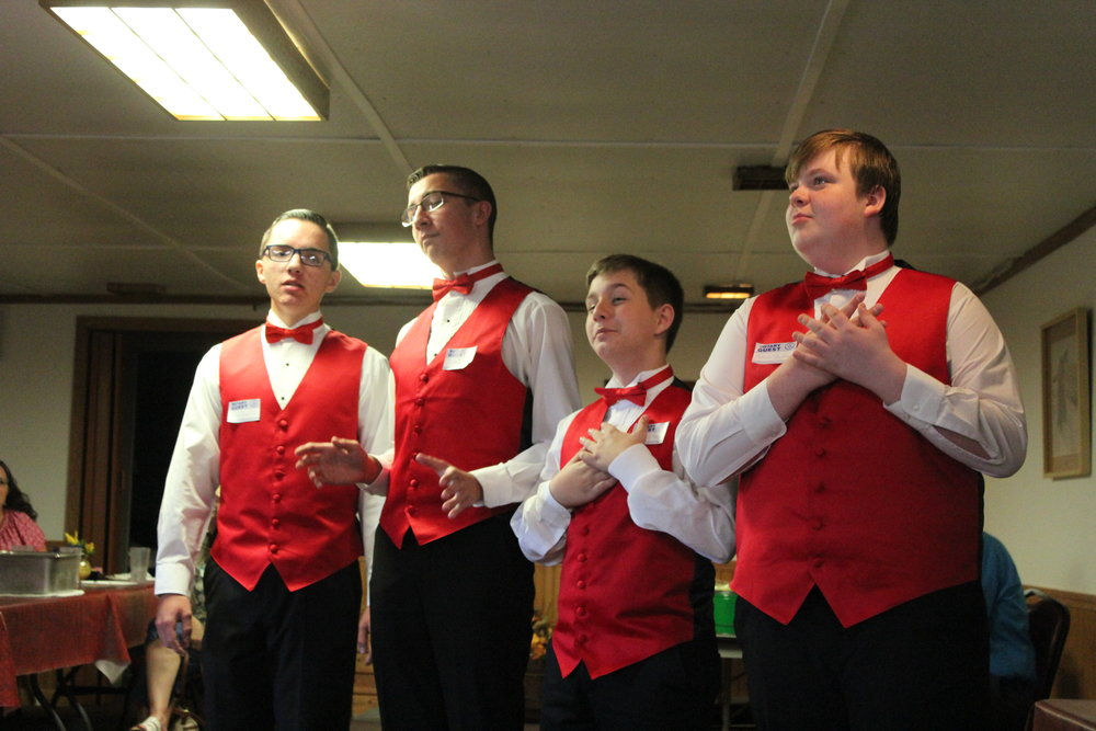 Smoot Theatre Boy's Quartet entertained the club with some old standards.