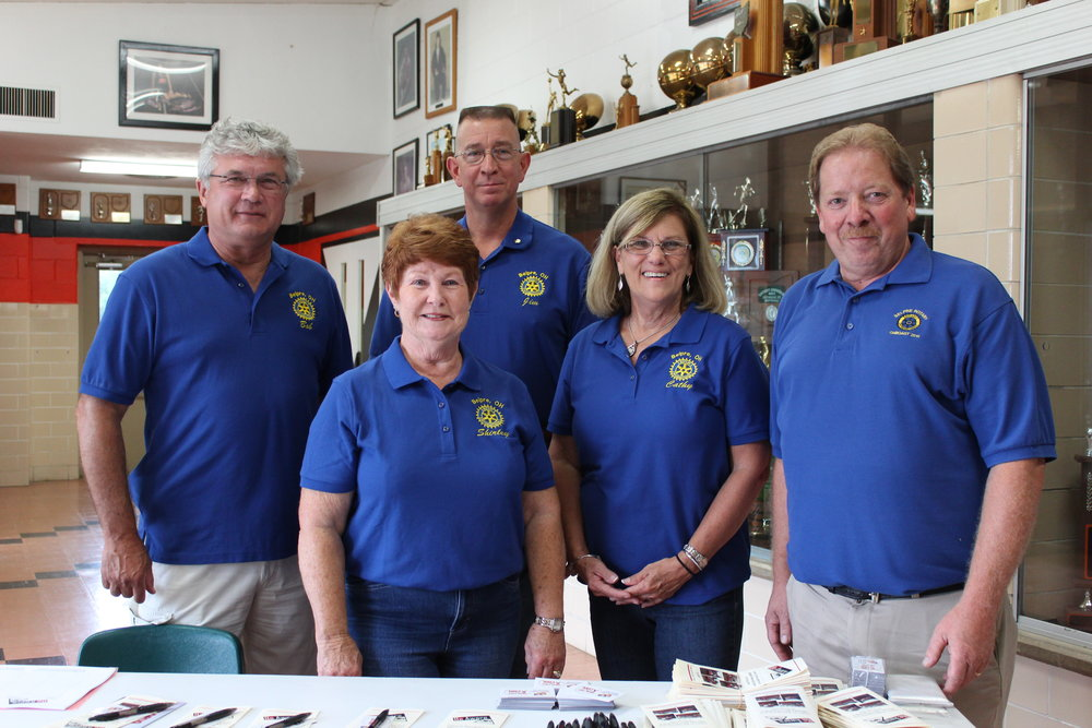 Belpre Rotarians Bob Rauch, Shirley Brown, Rev. Jim Condrey, Cathy Buttermore, and Dave Posey welcome the community to a drug prevention Awareness program (Be Aware) at Belpre High School, sponsored through Rotary funds and efforts.