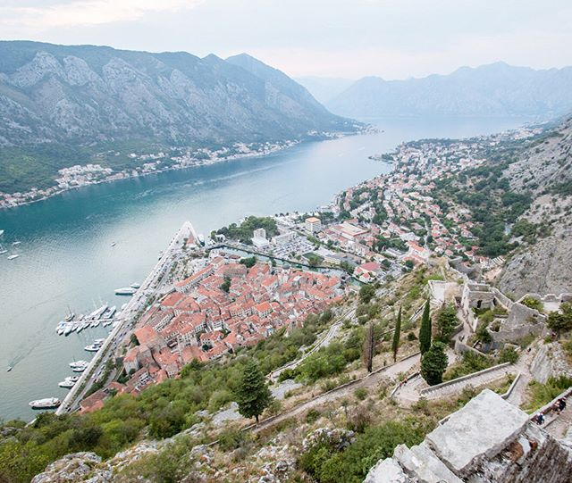 From atop the old fortress walls of Kotor, Montenegro, one gets a very special view of its beautifully-preserved old town, a compact labyrinth of centuries-old streets and quaint cafés nestled deep within the Bay of Kotor.