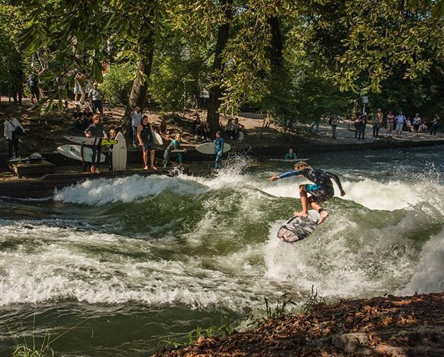 "Munich's Englischer Garten is a phenomenal urban park in its own right. But the ""Eisbachwelle""—a massive river wave—is perhaps its most recognizable feature, where crowds gather to watch surfers show off their skills in the ice cold water of the Eisbach River."