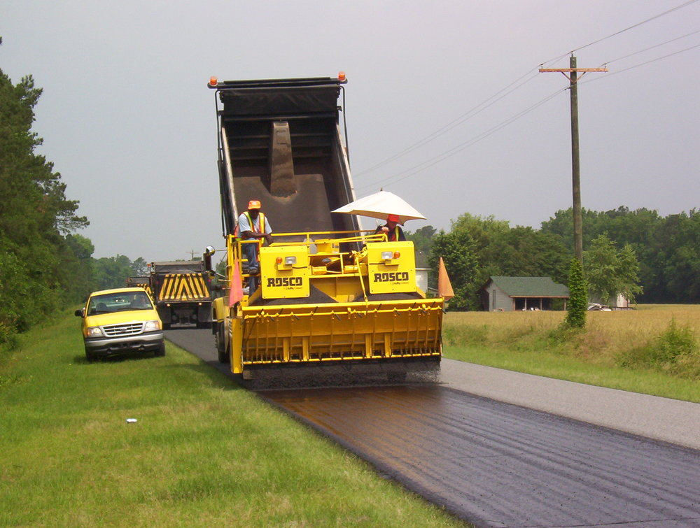 NCDOT, Division 3-Sampson County, NC - A chip seal crew working in Sampson County, applying STALITE lightweight road material over regular weight 78M. The road oil crews like the uniform application rates, on site delivery and reduced equipment stress that STALITE provides.