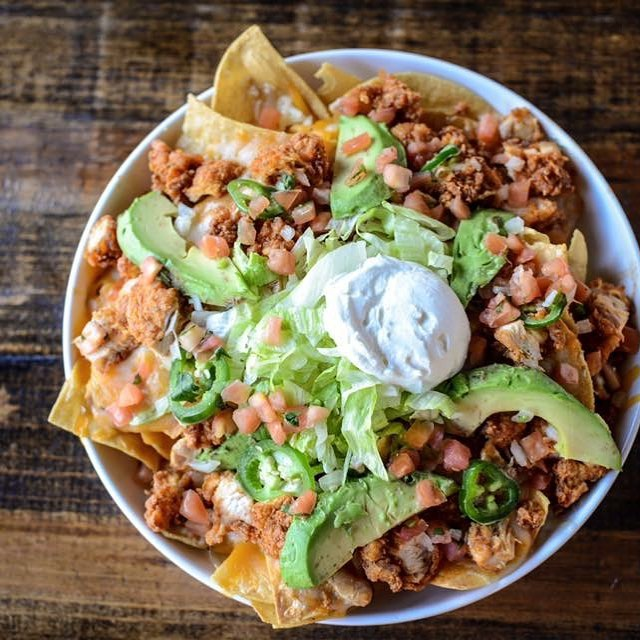 Baby it's cold outside...swing by for our Hot Chicken Nachos featuring bacon fried tortilla chips! Come see us Nashville. We will save you a seat!