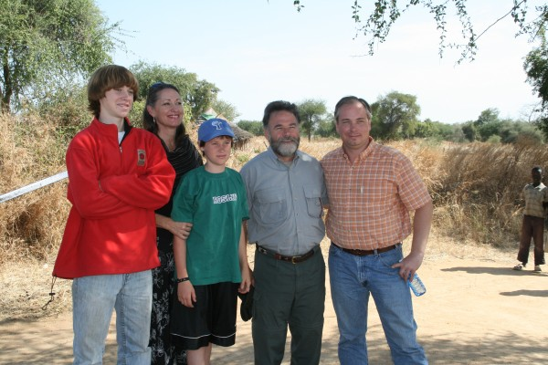Brad Phillips (right) with African Leadership president, Larry Warren and family.