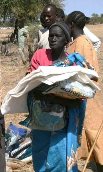 This woman receives relief supplies delivered by PPF.