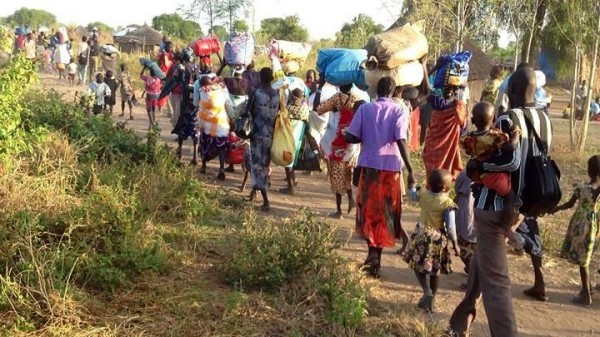 People fleeing villages in South Sudan. (photo credit: Jangdit Dengajok)