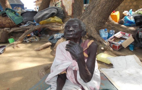 Elderly woman waiting for food at Konykonyo IDP Camp.