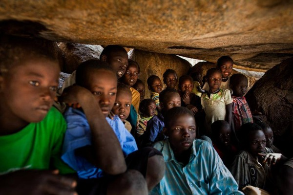 Children hiding in the rocks of the Nuba Mountains. (Photo courtesy Eyes and Ears Nuba)