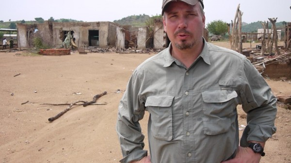 PPF President Brad Phillips standing in the center of a town completely destroyed by the Sudan government's bombing campaign.