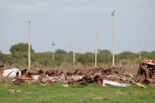 Bare power poles and rubbish mark where Abyei town used to be