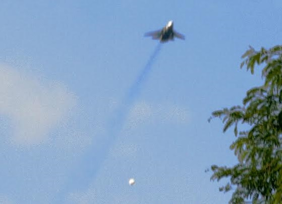 Jet fighter dropping a parachute bomb on the village of Kauda (photo courtesy of Nuba Reports)
