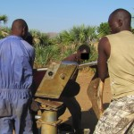 Well pump repair team in the Nuba Mountains