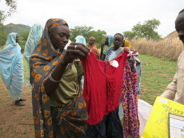 Nuba women receive dresses and other donated clothes for their families.