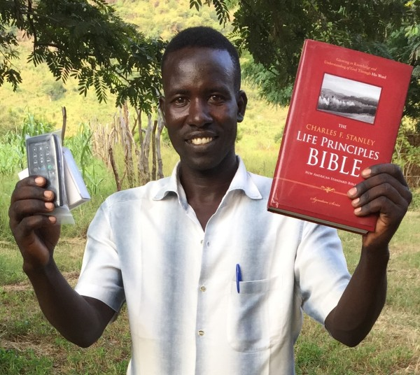 Pastor with Discipleship materials