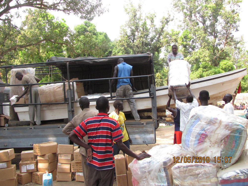 Loading a boat and relief supplies for transport to the Upper Nile.JPG