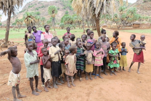 These orphaned children sang for us outside of Morris and Cabina's home, where they receive daily food...