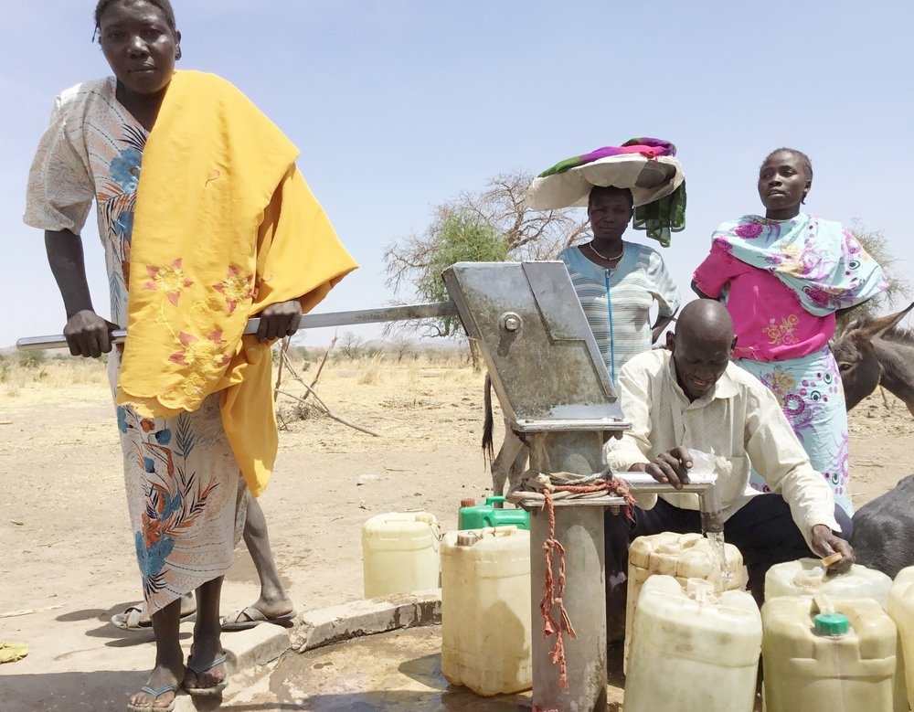 Samia at borehole.jpg
