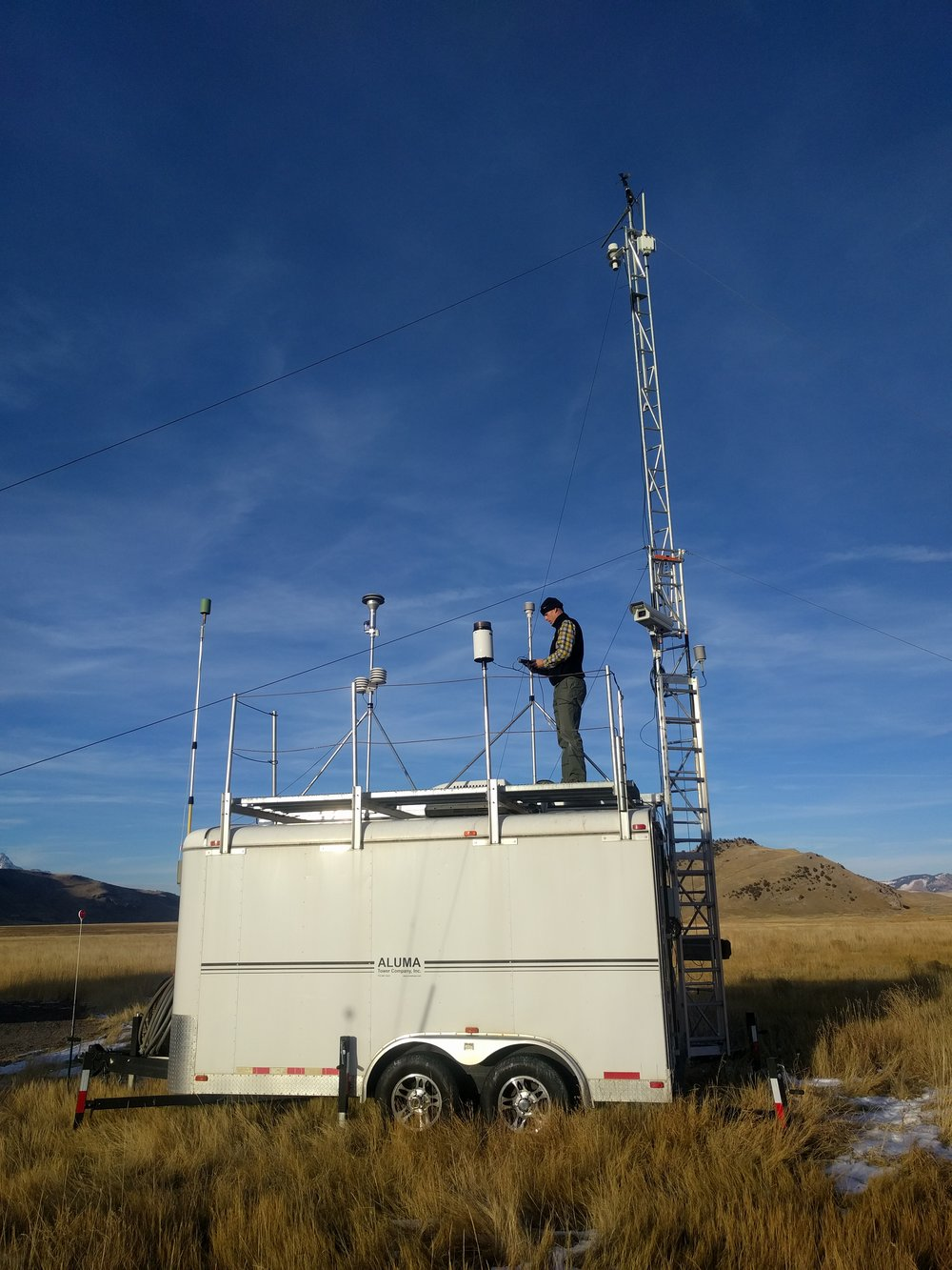 Robb checking on the instruments at the mobile air quality monitoring station.