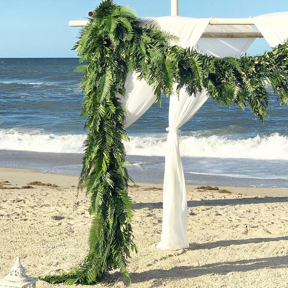 renee landry events table decor greenery fern garland altar wedding florals