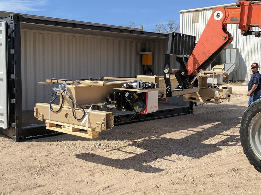 Using a Variable Reach Forklift to assist with the Setup/Packing of the CXT Explorer