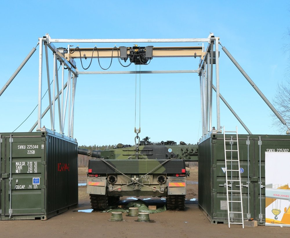 Mobile Lift System getting ready to pull the Engine on a Leopard Tank.