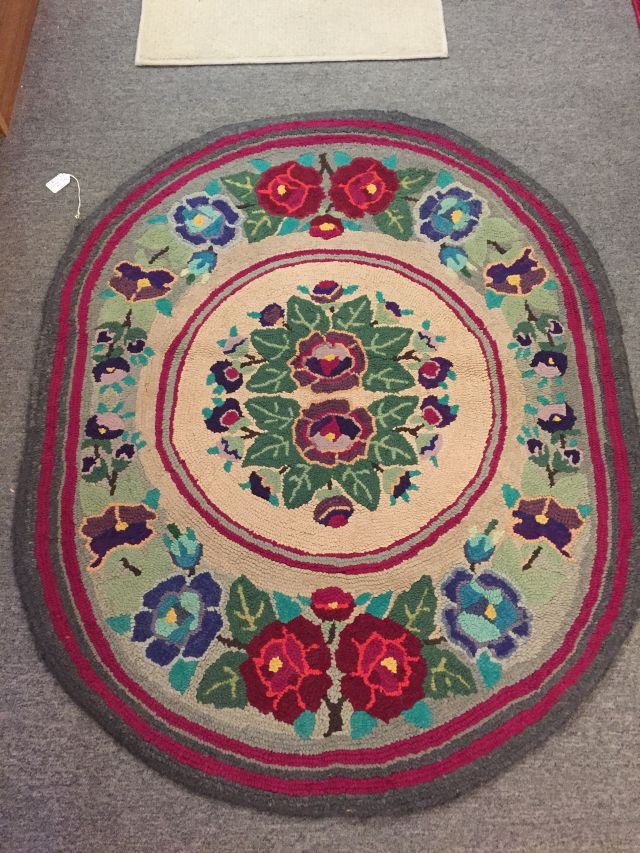 "2192003 Oval, Hooked Rug. Early 1900's. Floral motif. 46"" x 37"". $185"