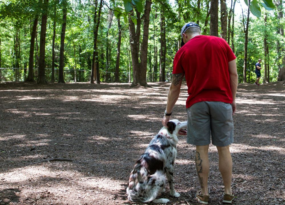 "Fontenot and Caliber take a break at a dog park. ""I've been single for six years, man,"" said Fontenot. ""This whole college thing isn't what I thought it was going to be like. But I got Caliber. And I'm sure I'll make it one day."""