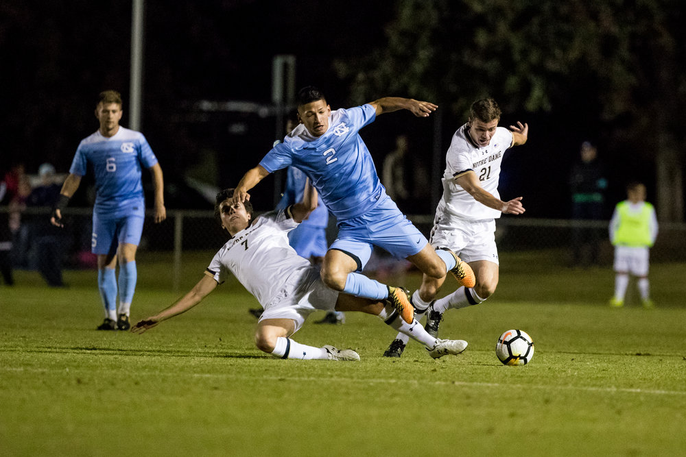 UNC's Maurici Pineda vaults a Notre Dame defender during a match on October 27, 2017. UNC would win the match 3 to 0.