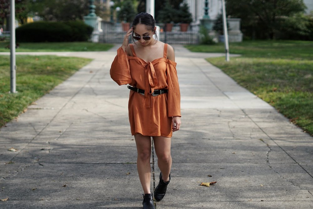 This off the shoulder flowy dress from Nordstrom rack is the perfect fall color. To add some edge to the dress I added a double buckle belt that I got off Amazon, and these no-heeled booties from forever 21 that are great for walking around all day on campus.