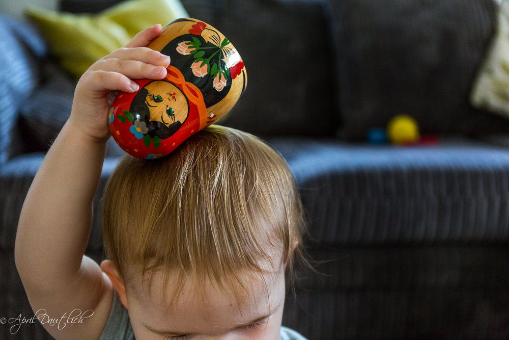 Hazel with nesting doll on head.jpg