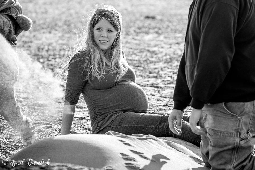 Pregnant mama sitting on beach
