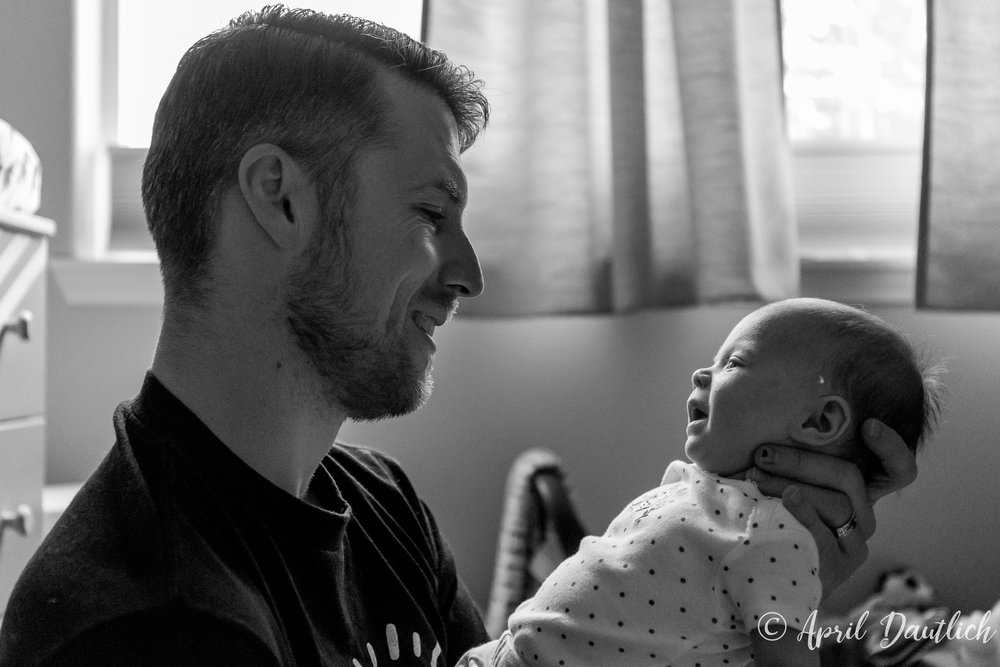 Dada looking at baby during family portrait session
